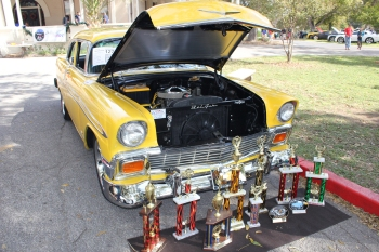 Yellow car and trophies